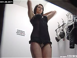 youthfull lady fitting hooter-sling in shopping mall
