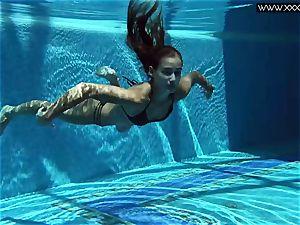 Tiffany Tatum undresses bare underwater
