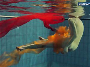 Yellow and crimson dressed teenager underwater